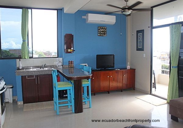 Living room is equipped with AC and overhead fans