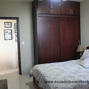 Master bedroom has a queen bed, AC, built-in closets