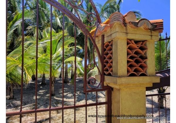 walled property with iron work on beach side to preserve view of beach and sunsets