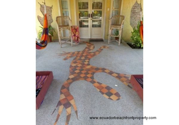 Upgraded finishes including this custom tile gecko on the guest hammocking porch.