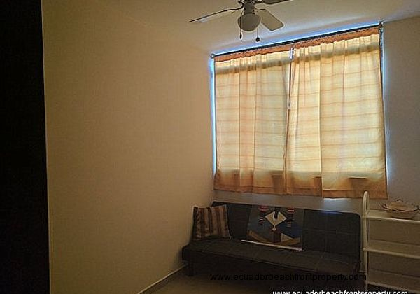 Guest bedroom has a sofa bed and built-in closet