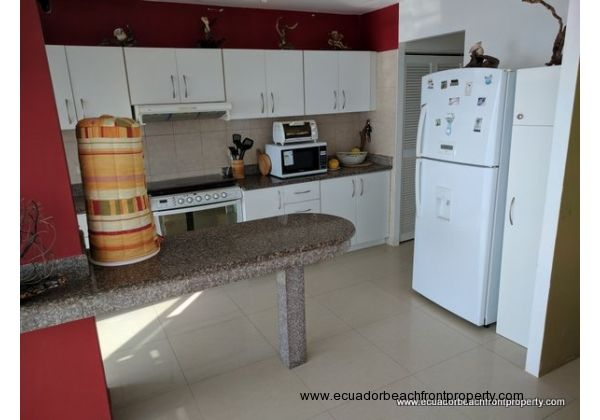 Granite countertops and plenty of kitchen storage available