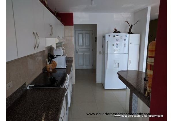 Kitchen comes with a 5-burner gas stove and oven, hood vent, microwave, toaster oven and refrigerator