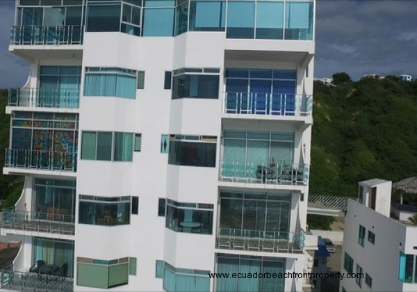 The 5D unit for sale is on the right with the patio furniture on the balcony