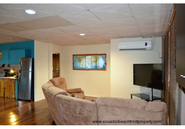 living room with A/C, 5 piece sectional sofa with built in recliners. 46