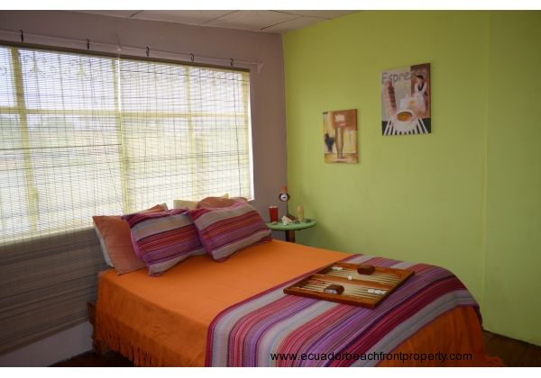 Guest room with full size bed.  All bedding included.  Bedside table and lamp.  Wired 220 for A/C