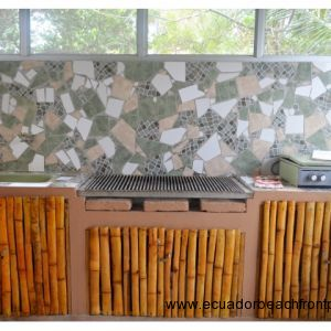 Custom mosaic cook station with built in BBQ, sink and table top four burner propane cook stove