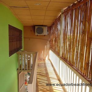 west side covered balcony. With wood floors and bamboo siding. Window overlooking west lot
