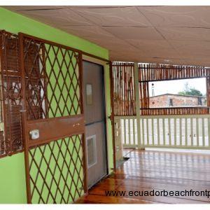front covered balcony.  Wood floors. Entrance door with screen door to home.