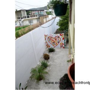 looking down from covered front balcony into yard