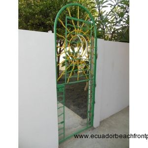 Custom iron gate with sun on upper section and moon on lower which folds up for doggie door into orchard lot