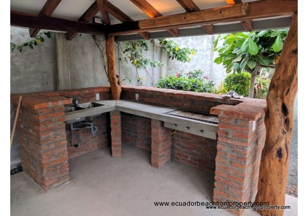 Outdoor kitchen and custom stainless steel grill