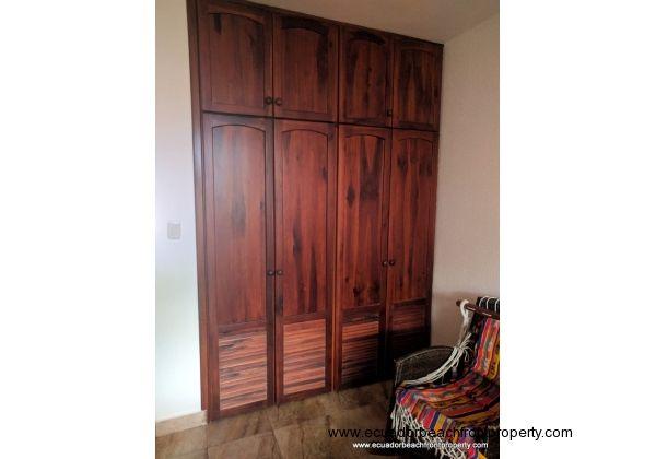 Custom wood storage in second bedroom