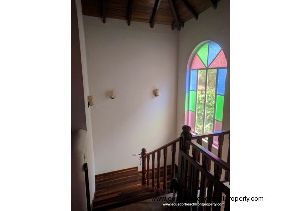 Hardwood and stained glass in the stairwell