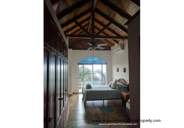 Master bedroom with high ceilings and beautiful woodwork.