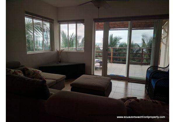 Living room views toward the balcony and ocean