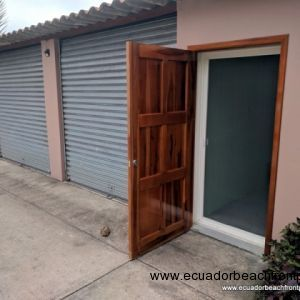 Outdoor garage and secured storage area with laundry room