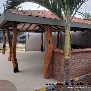 Covered outdoor kitchen, hammock and social space