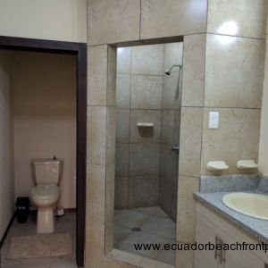 Ensuite master bath with double sinks, walk-in shower and a separate water closet