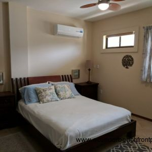 Master bedroom with queen bed, overhead fan and AC