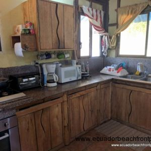 Kitchen has a double sink, 5-burner gas stovetop, electric stove, high volume refrigerator