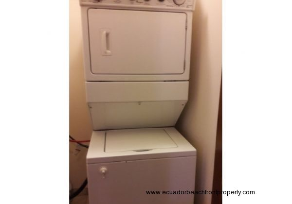 Stacked Whirlpool brand washer and dryer