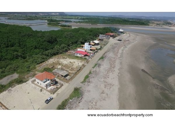 The house is located on a stretch of sandy beach backed up to forested reserve and near the mouth of a river