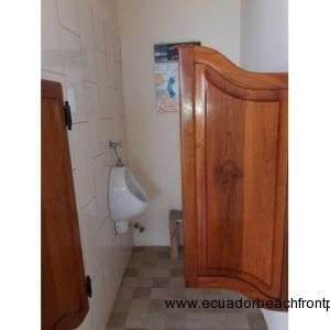 Urinal room with swinging saloon doors
