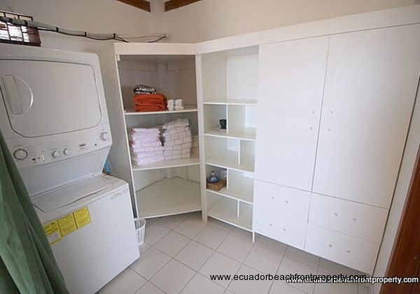 Off the bedroom is a spacious closet and laundry area