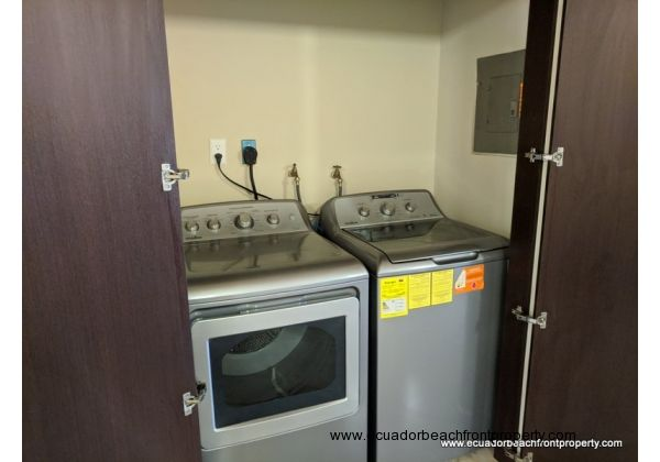 Laundry closet with washer and dryer