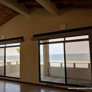 Double sliding doors lead to the stunning ocean front balcony
