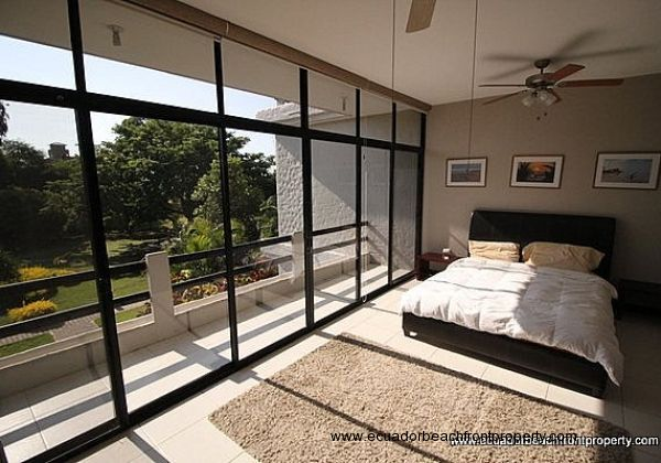 Upstairs is the master bedroom with private garden view balcony