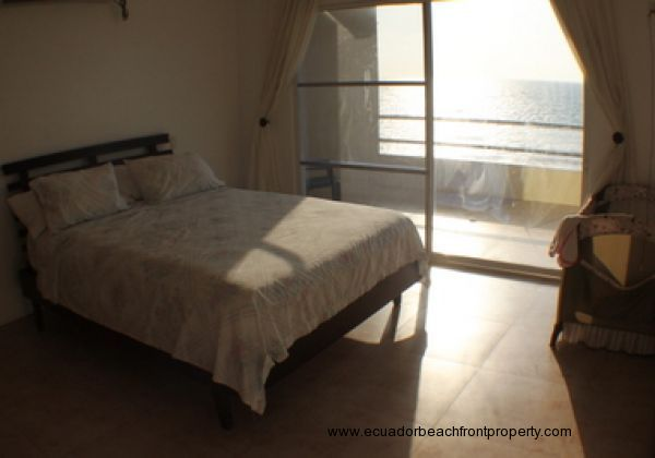 Master bedroom with ocean views and access to the balcony