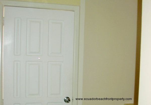 Front door with storage cabinets above
