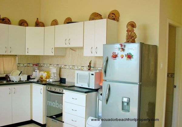 Refrigerator, gas stove/oven, microwave oven and water cooler included.