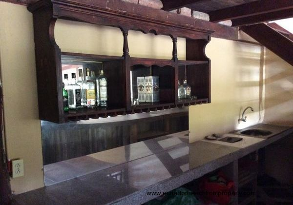 Liquor cabinet behind bar