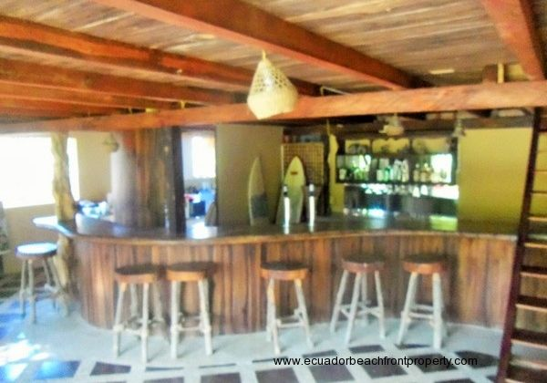 Custom built hardwood bar. Custom bar stools included!