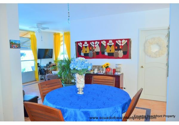Dining area.  Door with wreath leads to bedroom