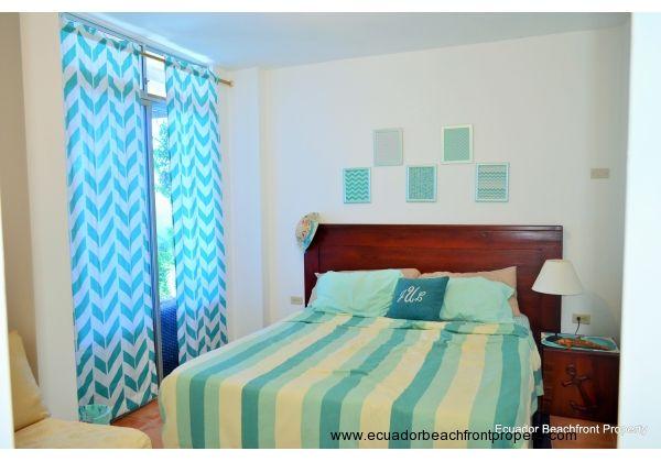 1st level bedroom. Jack & Jill bath to hall. sliding doors to poolside patio