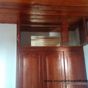 Upper doors of the closet open to the next bedroom to allow great air movement from the front of the house to the back.