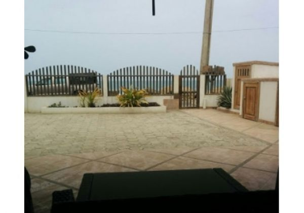 Wicker lounge set with oceanfront view