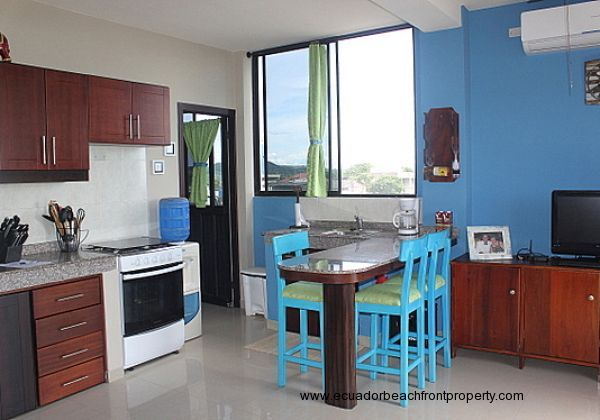 The kitchen has a gas stove and oven, microwave, and refrigerator as well cookware, dishes, etc.