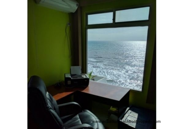 Master bedroom has a oceanview nook that is currently used as an office