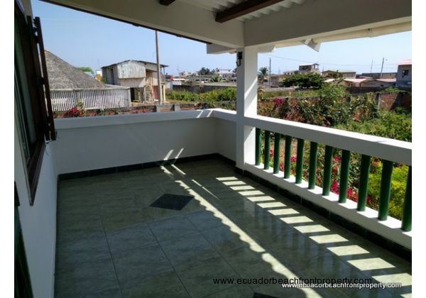 The covered terrace offers a quiet spot to enjoy the breeze and views of the ocean and garden