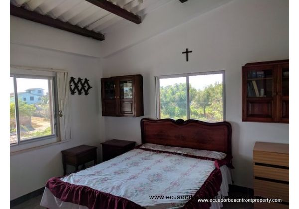 Master bedroom has vaulted ceilings, built-in closets, excellent ventilation, and a full bathroom