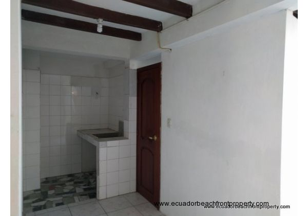 The large second bath has a wash basin, area for a washer and dryer, large walk-in shower and a separate toilet and sink
