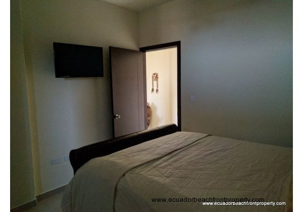 Master bedroom has overhead fan, AC, wall-mounted TV, built-in closet and an ensuite bath
