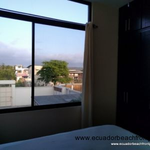 2nd bedroom with large picture windows, full-size bed, overhead fan, AC, and built-in closet
