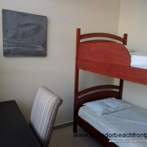 3rd bedroom is equipped with a desk and bunk beds