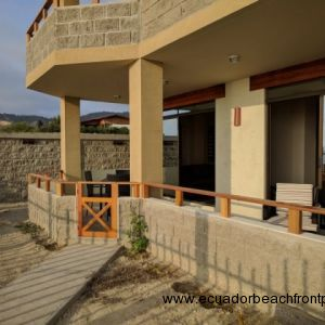 Spacious covered, beachfront patio with walkway to the beach and pool